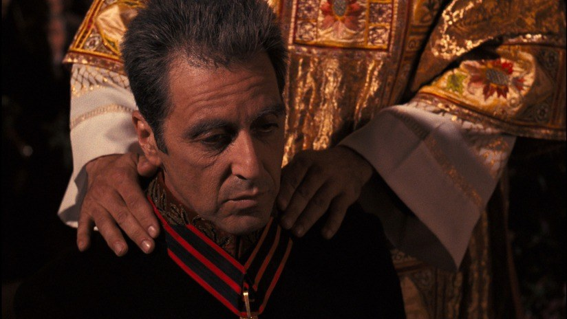A man looking into nothingness with a priest' hands on his shoulder The Godfather Part III