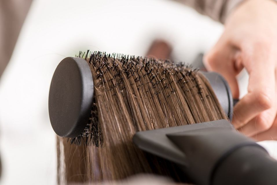 drying brown hair with hair dryer