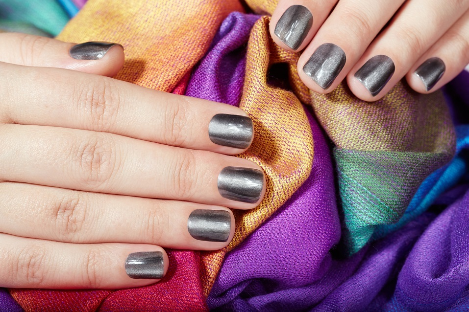 Hands with gray metallic manicured nails