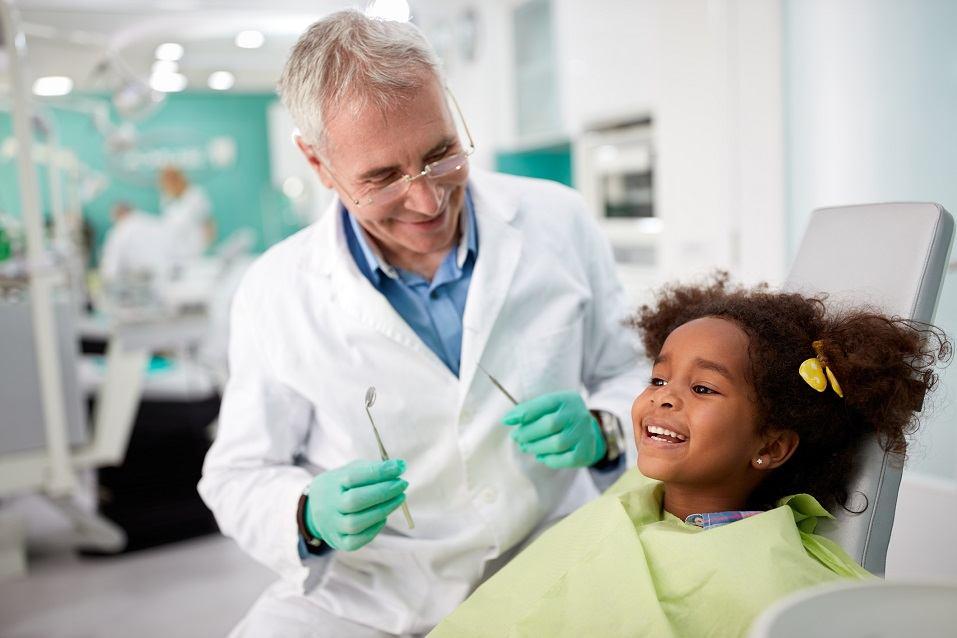 Happy kid on dental chair