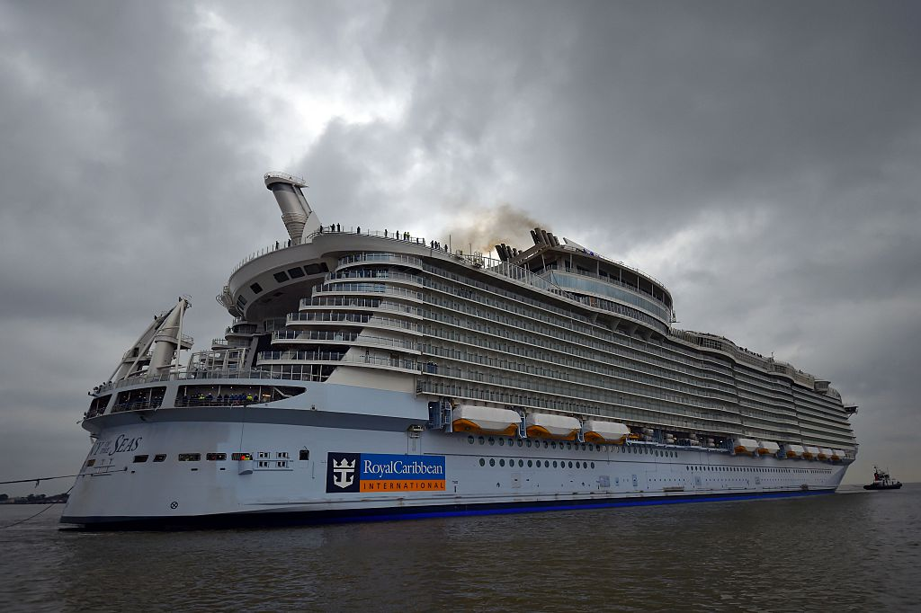 """The cruise liner """"Harmony of the Seas"""" is towed by tug boats into its new moorings at the STX Shipyards"""