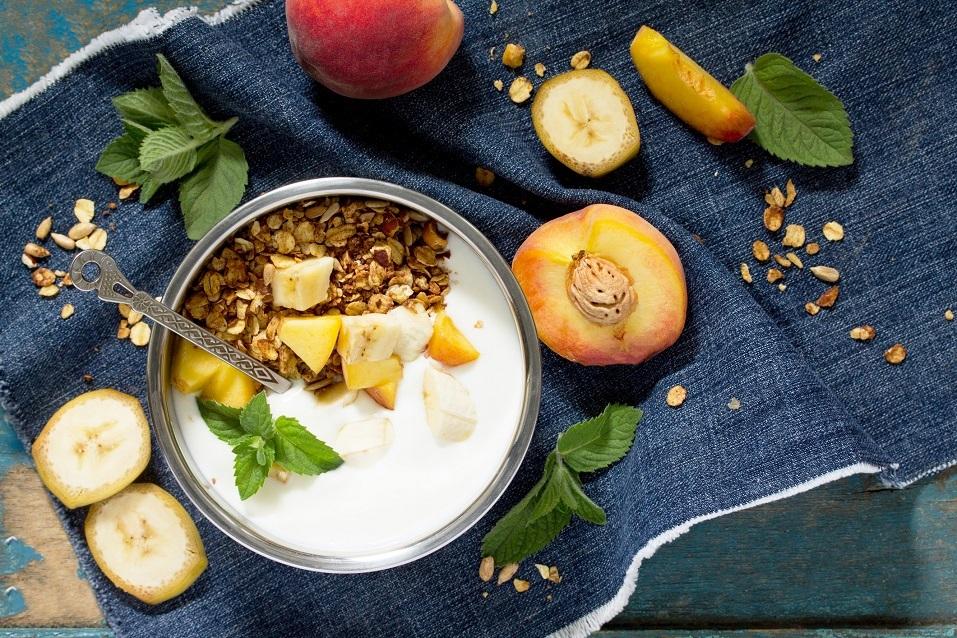 Healthy breakfast of muesli with fruit, raw oats and yogurt