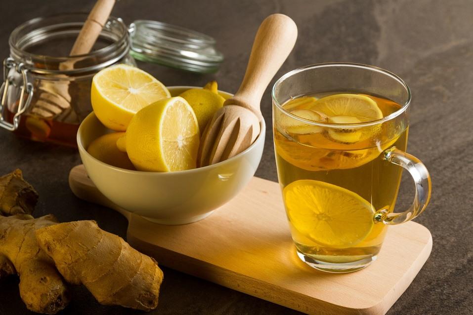 hot tea next to bowl of lemons