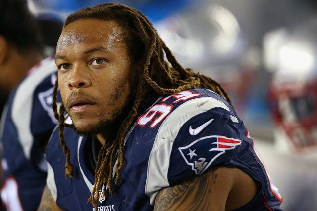 Jabaal Sheard of the New England Patriots looks on from the bench during a game.