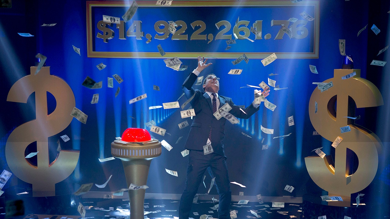 John Oliver in a cloud of cash