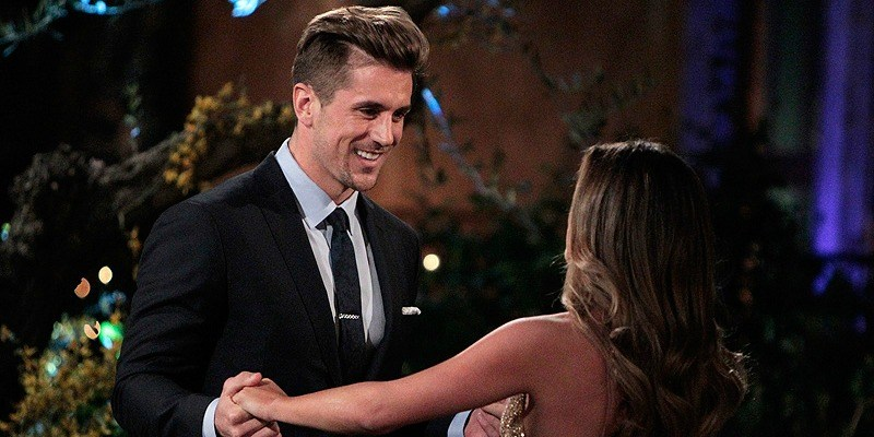 Jordan Rodgers smiles and holds JoJo's hands on The Bachelorette