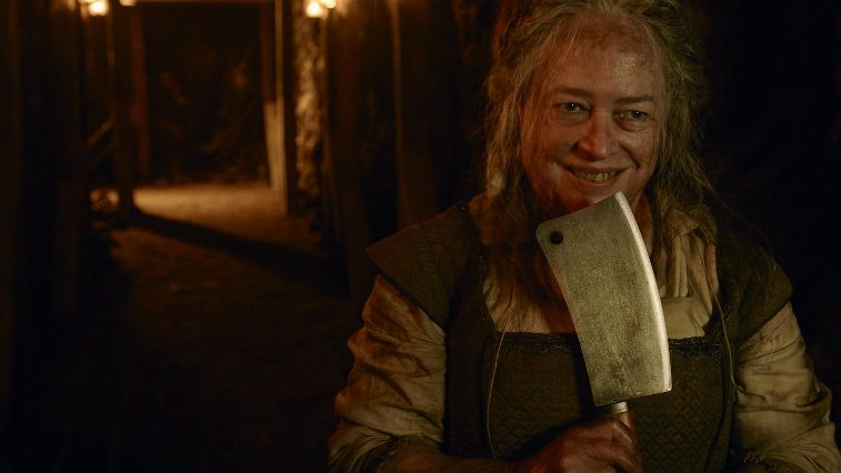 Kathy Bates holds an cleaver and dons dirty clothes in American Horror Story: Roanoke