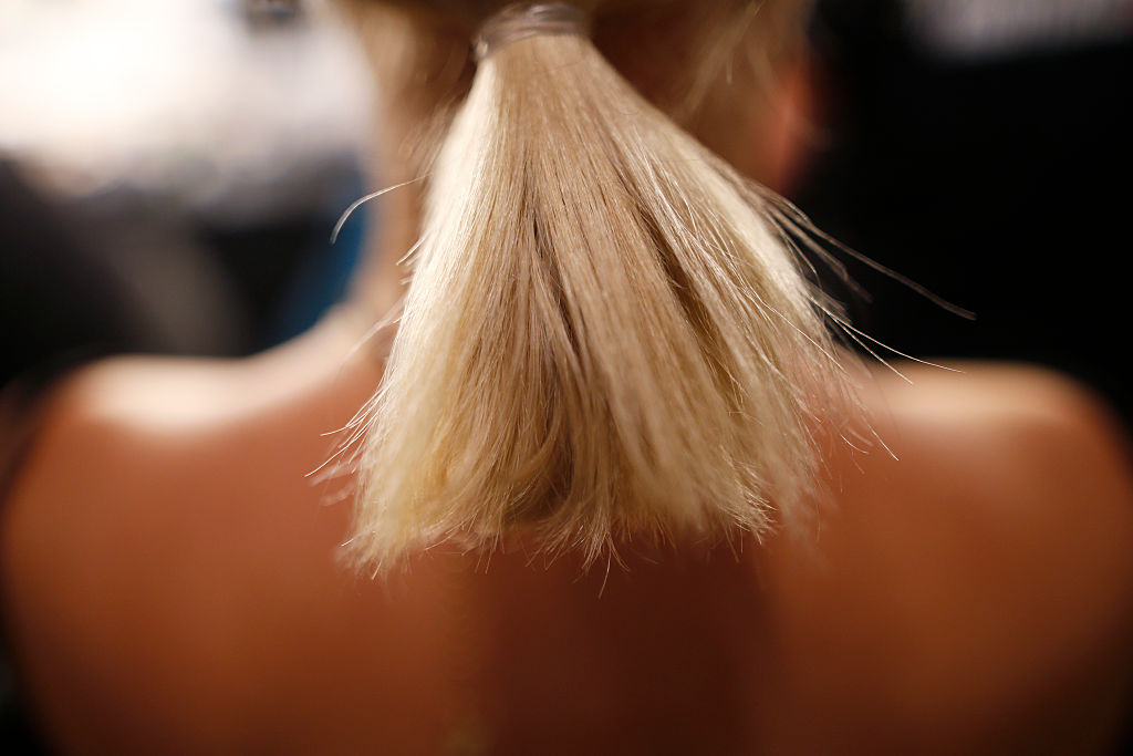 A model (hair detail) is seen backstage ahead of the Laurel show during the Mercedes-Benz Fashion Week
