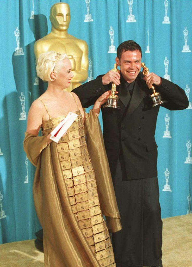 Australians Lizzy Gardiner and Tim Chappel, the former is wearing a dress made out of AMEX cards