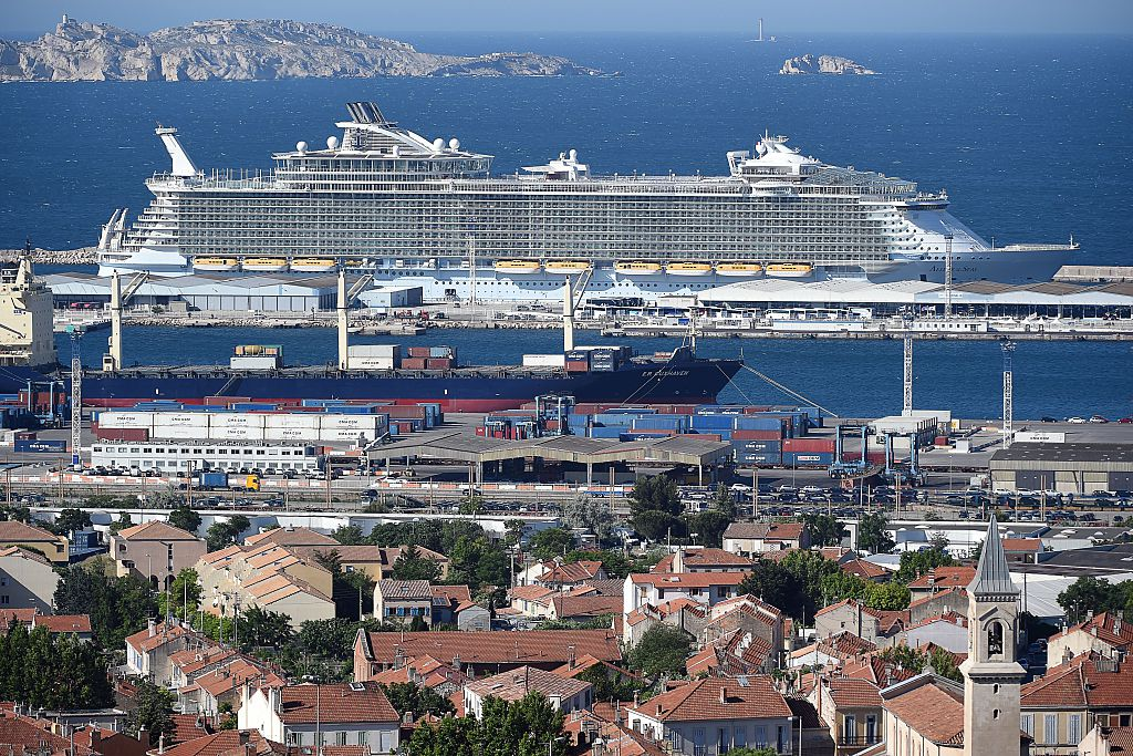 Allure of the Seas dwarfs all of the buildings nearby while anchored in port.
