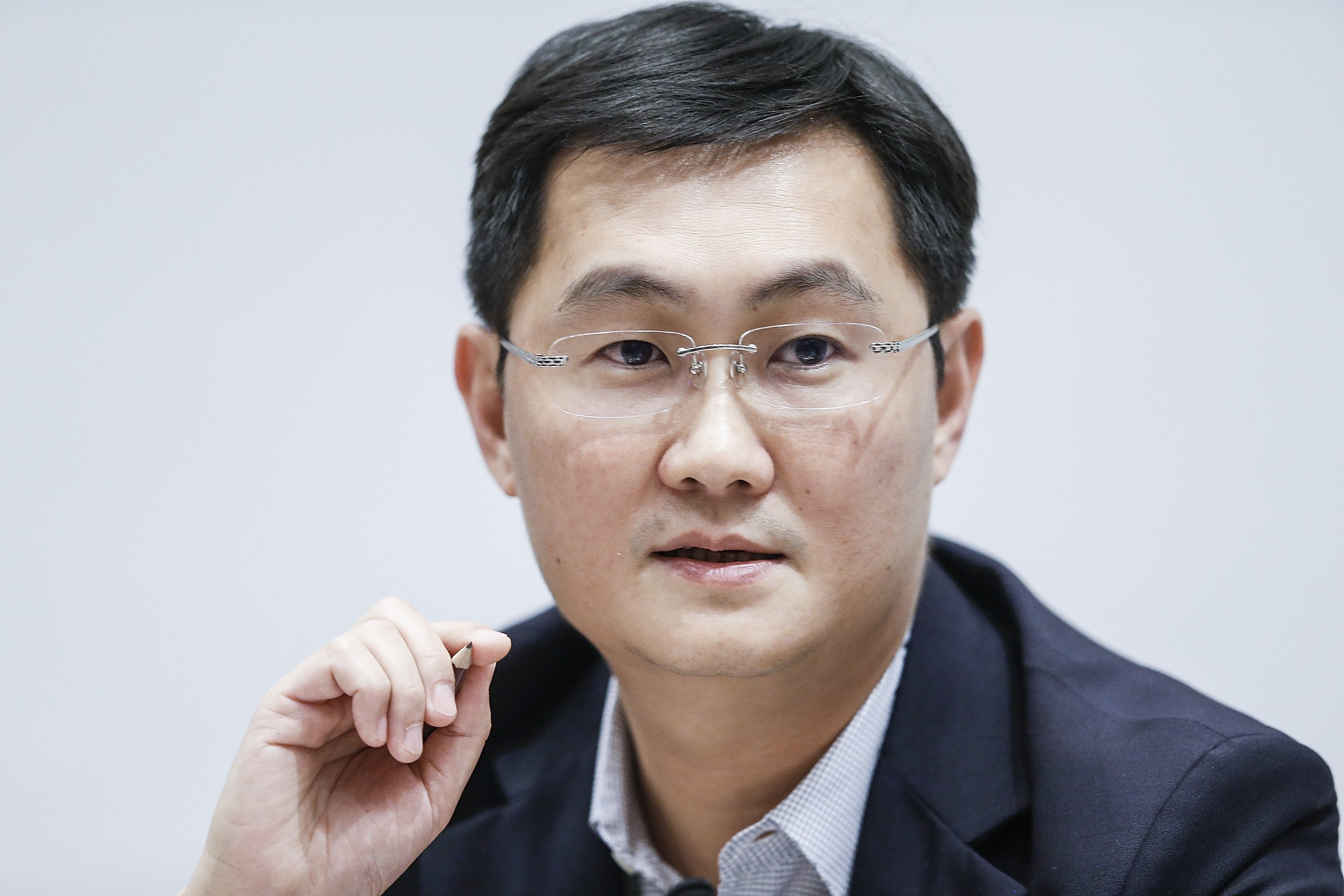 Pony' Ma Huateng, chairman and chief executive officer of Tencent Holdings Ltd., speaks at a news conference