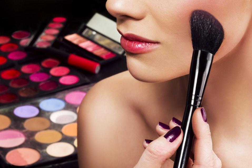 Makeup artist applying blusher