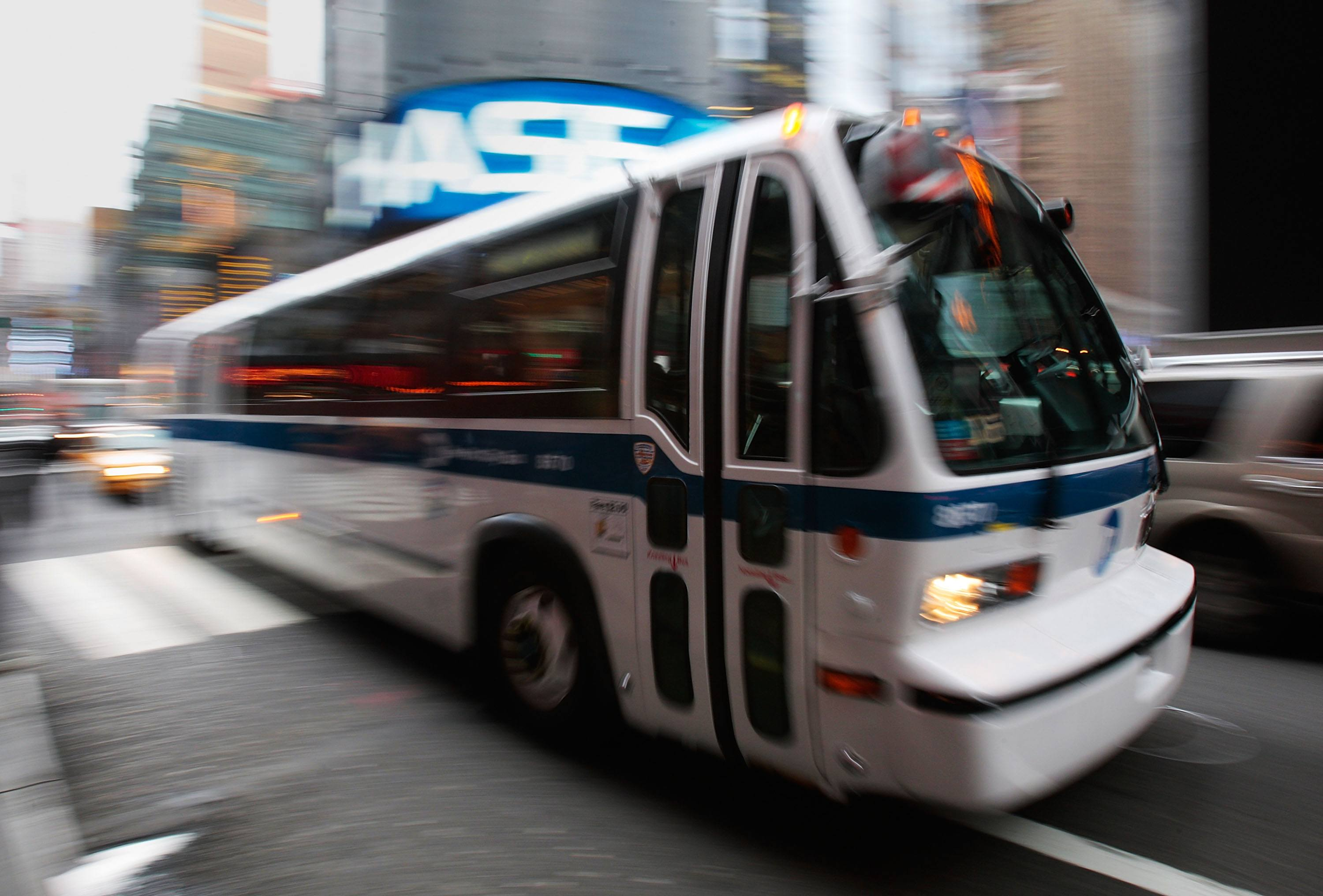 A New York City bus moves by in Times Square
