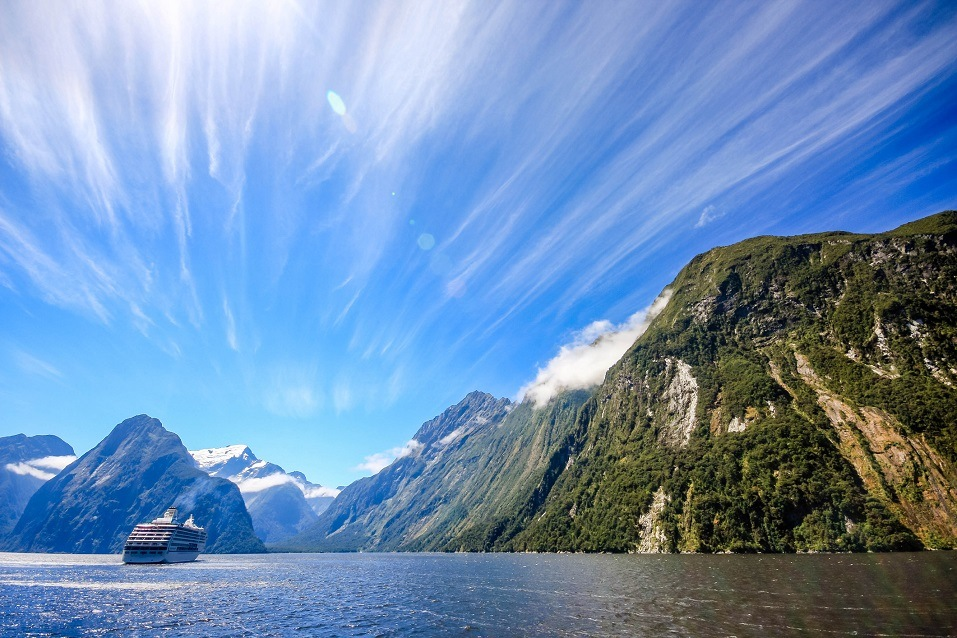 A cruise ship heads to Milford Sound, New Zealand