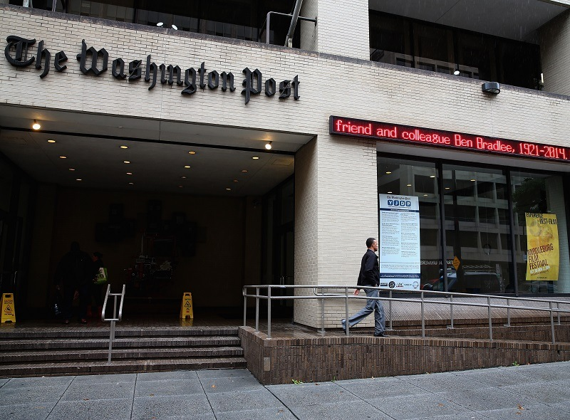 A scrolling marquee in front of the Washington Post building