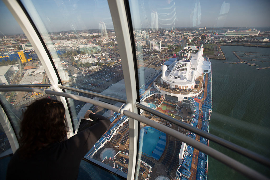 A visitor takes a photograph from the North Star observation capsule onboard the cruise ship Quantum of the Seas