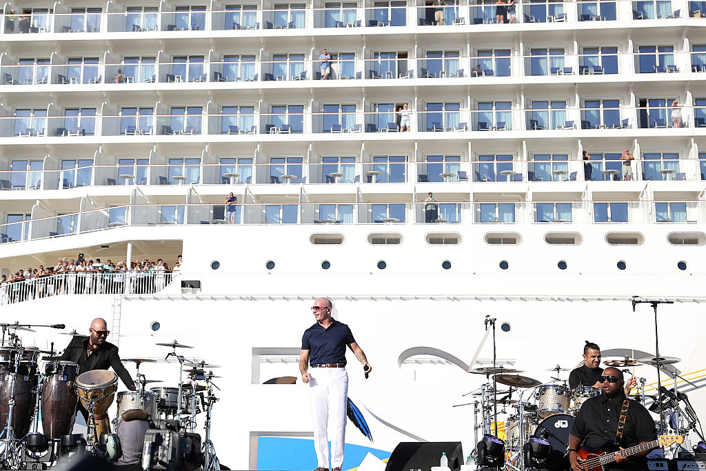 Pitbull performs onstage at the Christening Ceremony for the Norwegian Escape