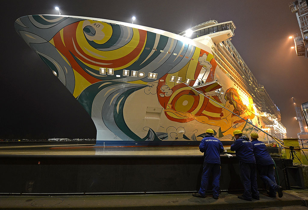 Employees of the Meyer Werft shipyard watch the Norwegian Getaway cruise