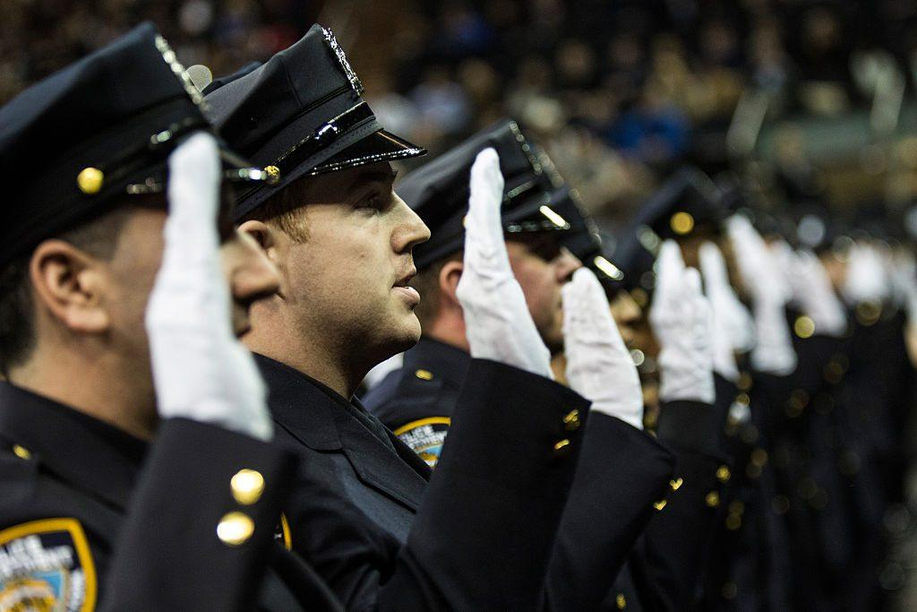 police officers taking an oath