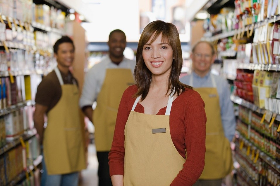 Shop assistants standing in a store aisle