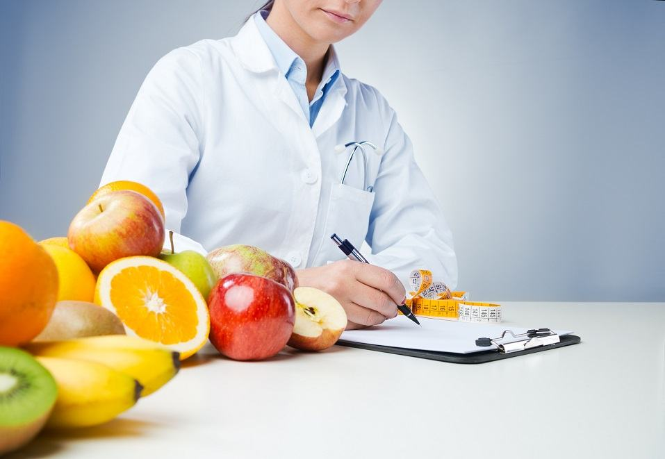 nutritionist working at desk and writing medical records