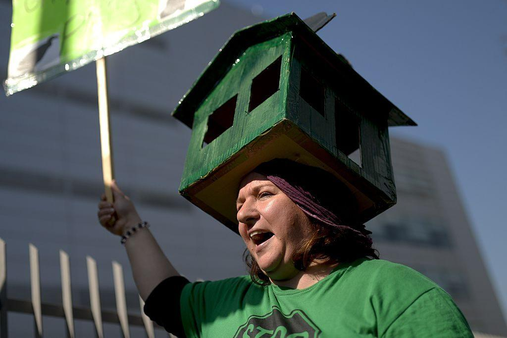 woman protesting housing costs