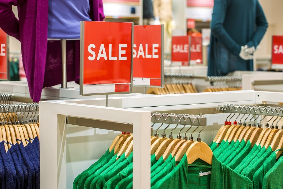 Sale sign over clothing in a store