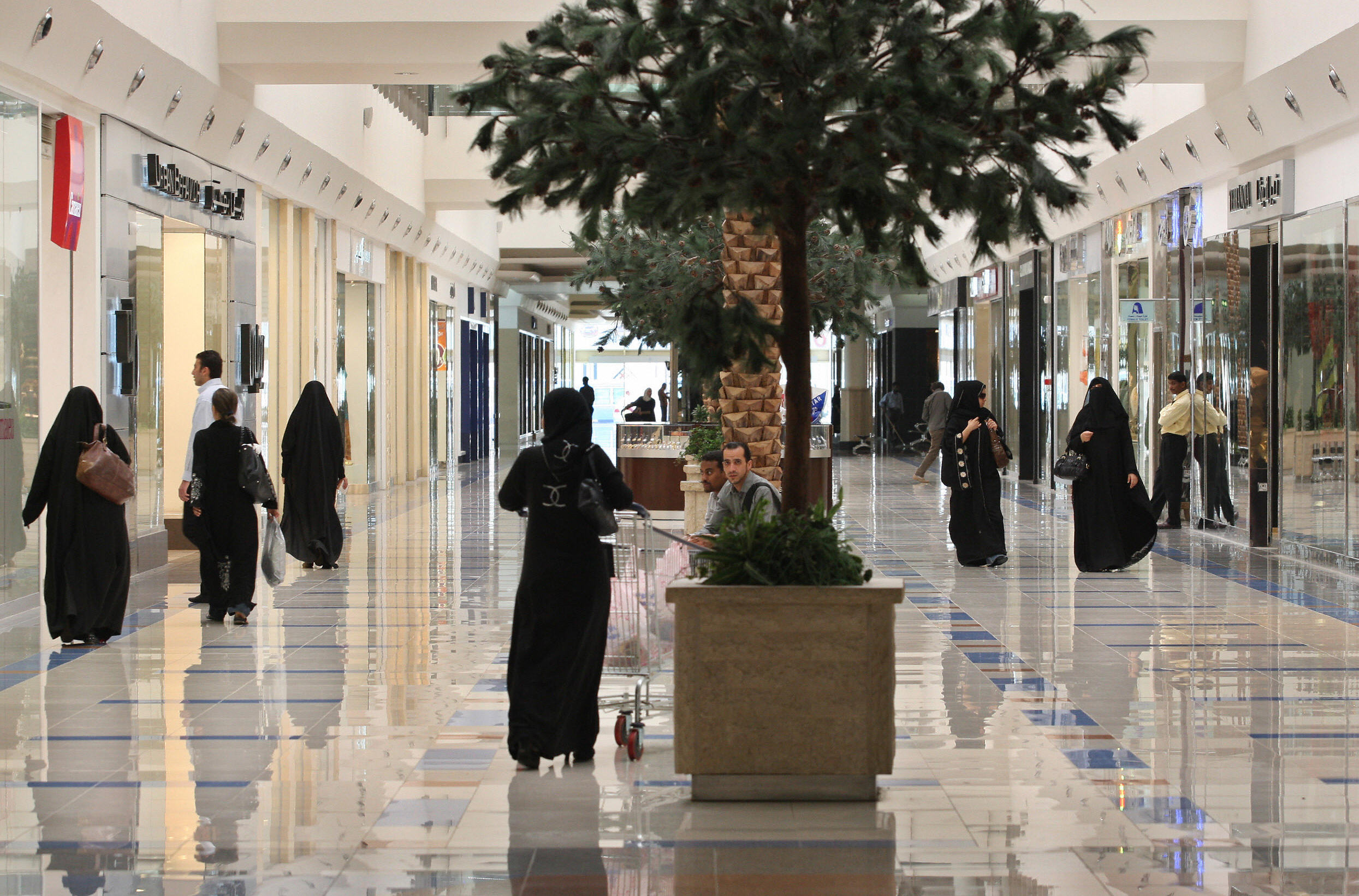 Saudi women walk at a shopping mall in the Saudi capital of Riyadh