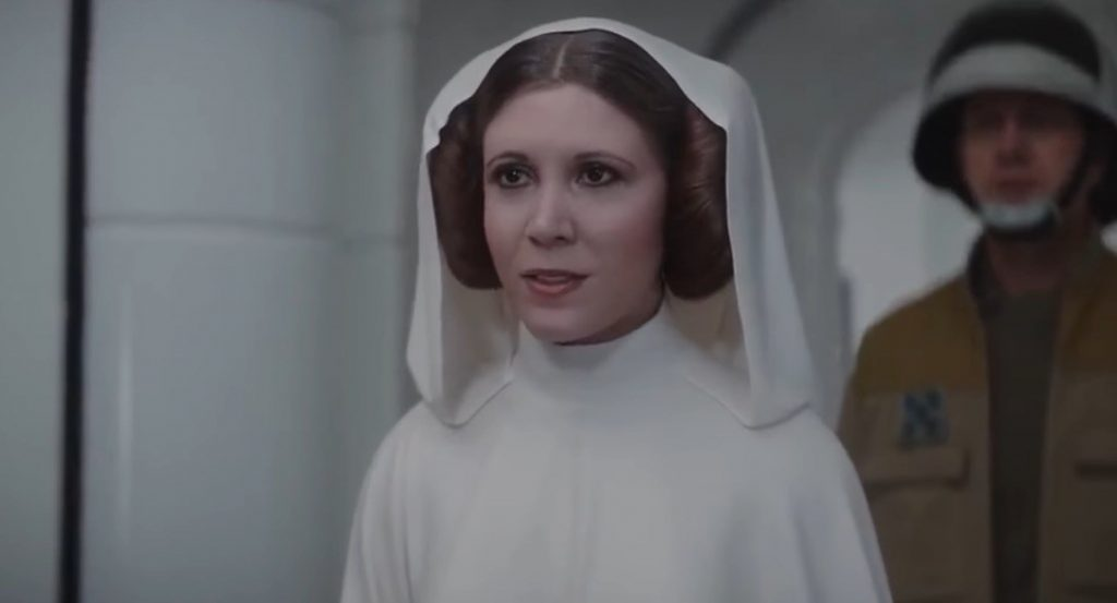 Princess Leia in her trademark white robe and buns, looking off into the distance