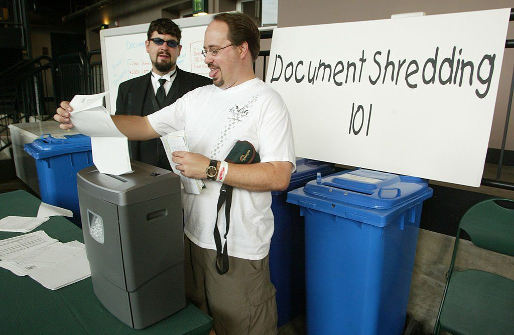 man shredding papers