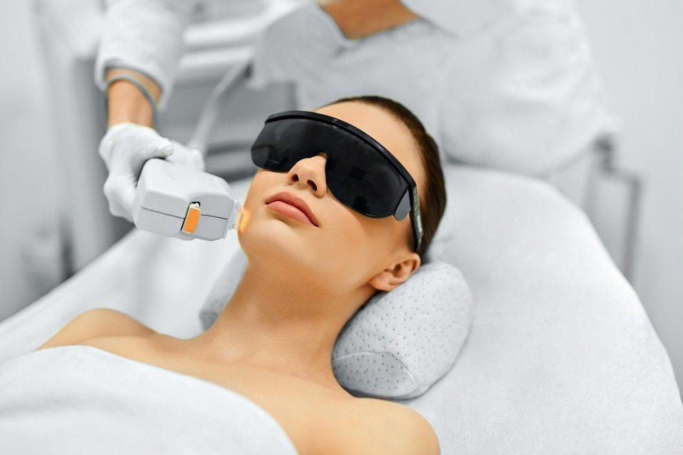 Young Woman Receiving Facial Beauty Treatment