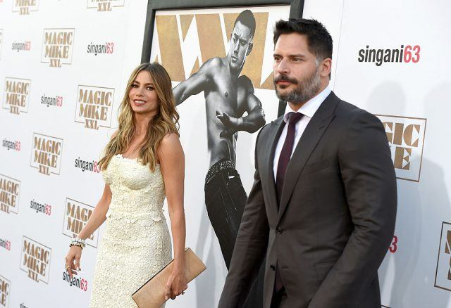 Sofia Vergara and Joe Manganiello pose together for the paparazzi while on a red carpet.