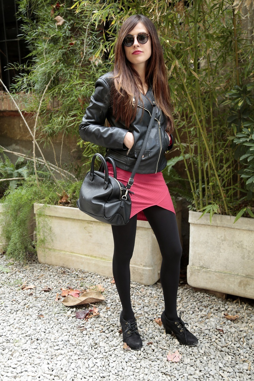 Woman wearing a Zara leather black jacket, Bershka red dress and handbag