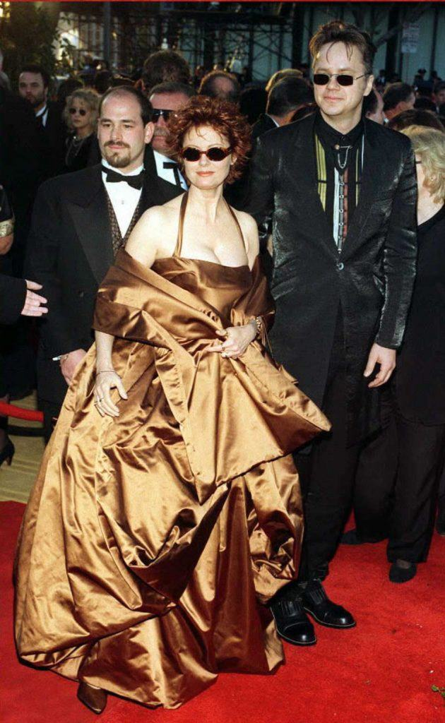 Actress Susan Sarandon and director Tim Robbins at the 68th Annual Academy Awards, the former is wearing a bronze satin dress