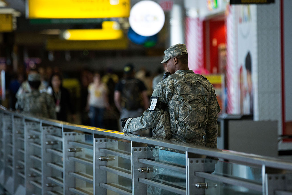 Members of the U.S. Army patrols along a concourse in the departures area at LaGuardia Airport