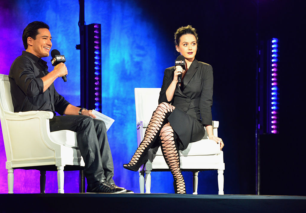 TV personality Mario Lopez and singer-songwriter Katy Perry speak onstage