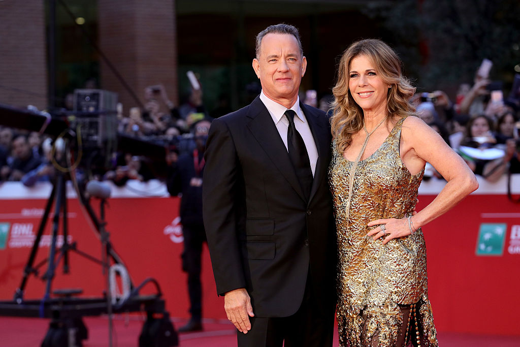Tom Hanks and Rita Wilson walk a red carpet