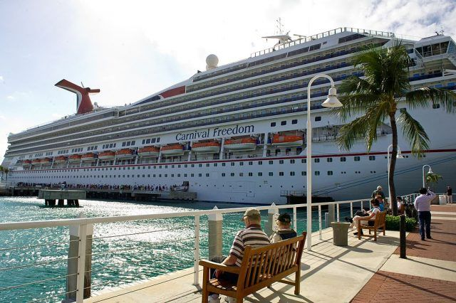 The Carnival Freedom cruise ship awaits its passengers in the port