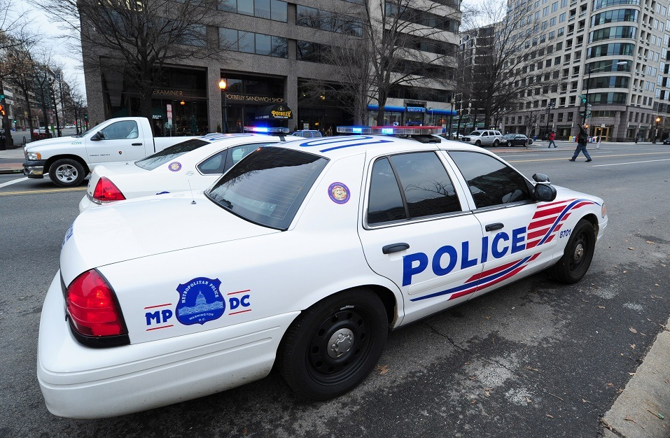 Police cruisers parked on a street in Washington, DC