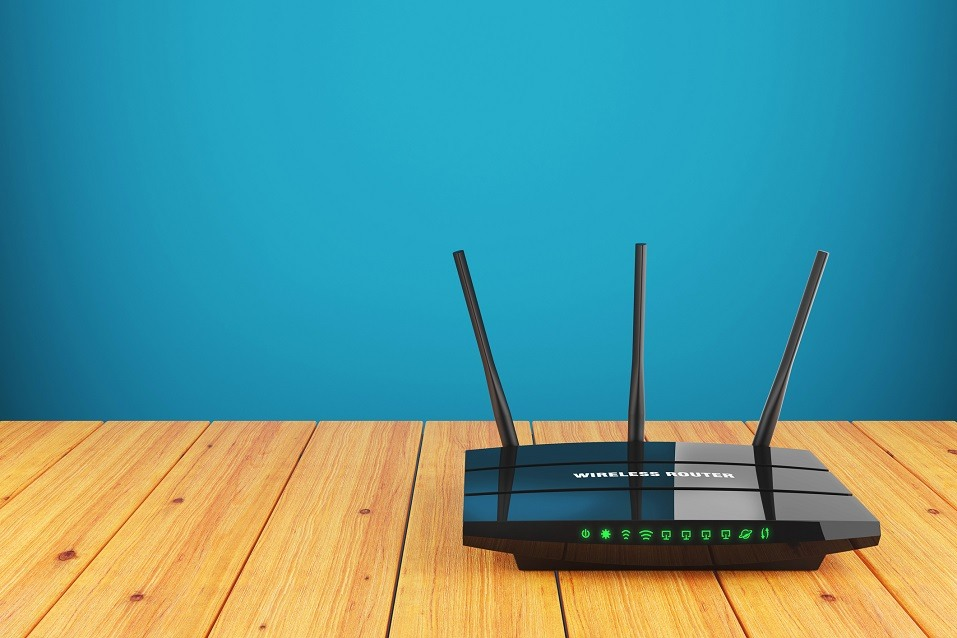 Wi-Fi wireless router on wooden table