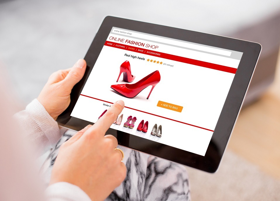 Woman using digital tablet to shop