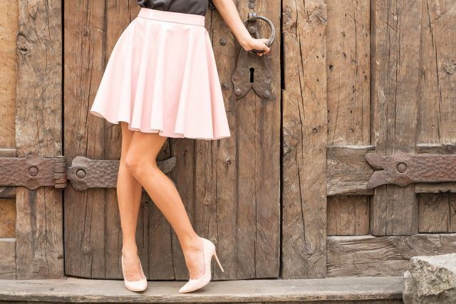 woman wearing a nude-colored skirt with matching heels