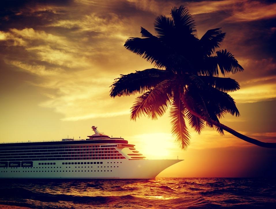 A cruise ship moves slowly along the ocean