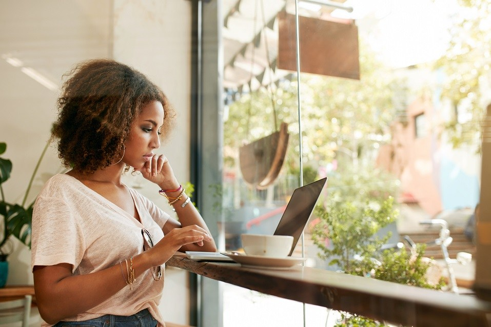 woman at cafe using laptop