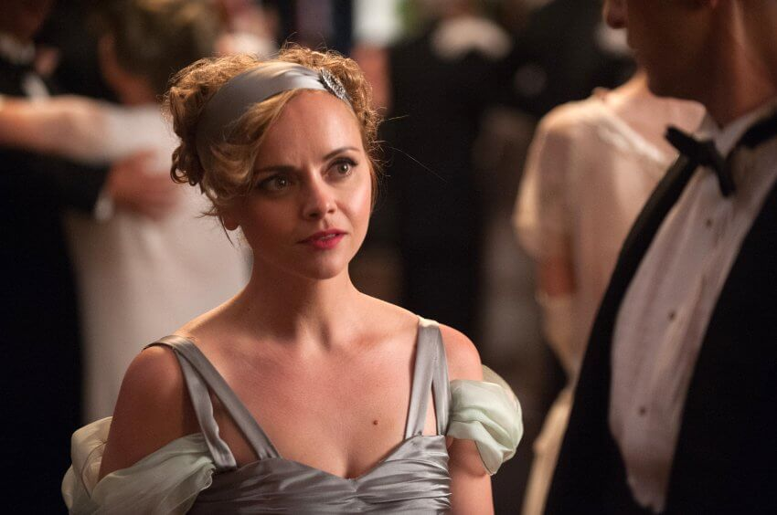 Christina Ricci stands in a dress as Zelda Fitzgerald