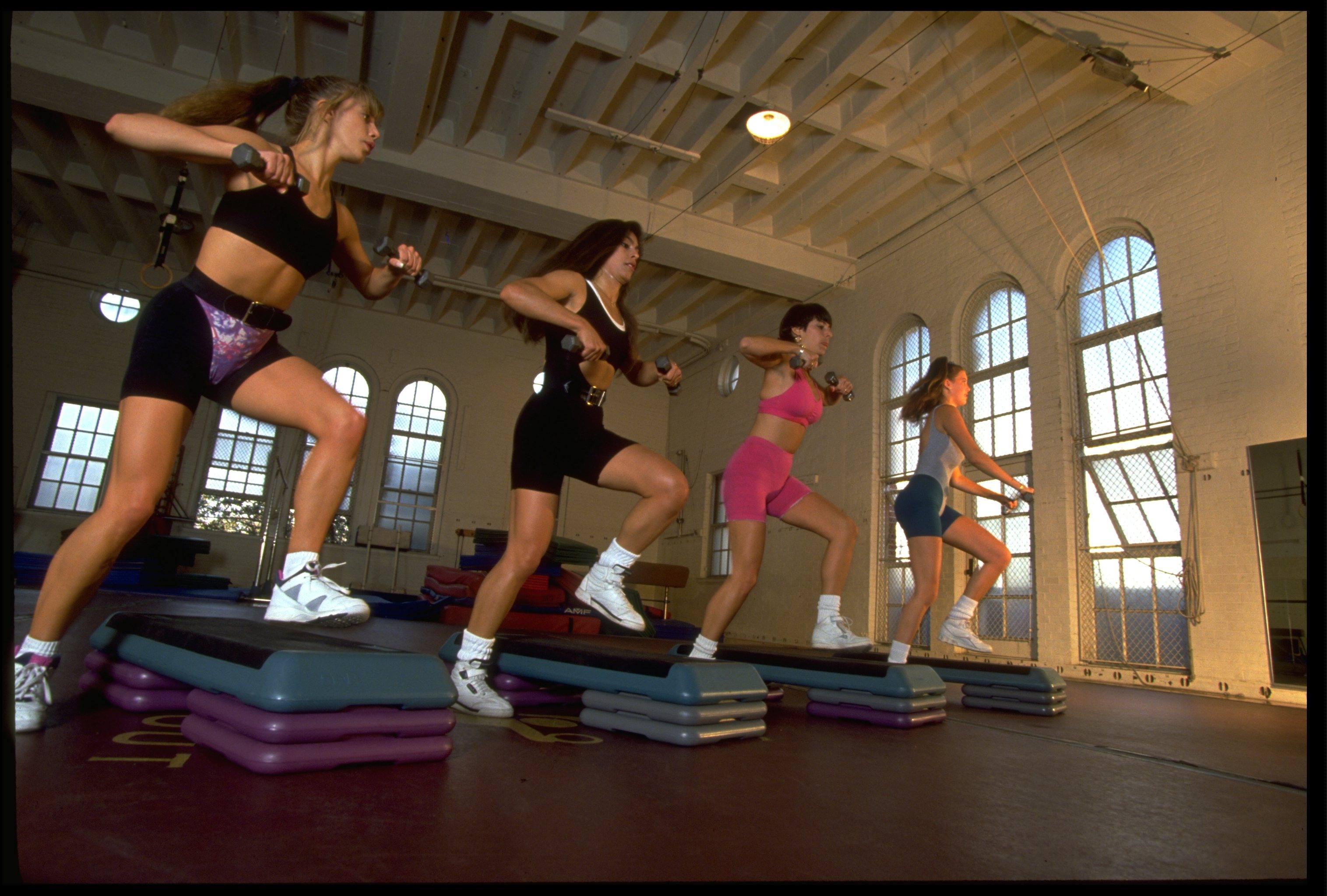 Women participate in an aerobics workout