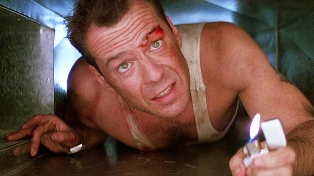 Bruce Willis is crawling in an air vent in Die Hard.
