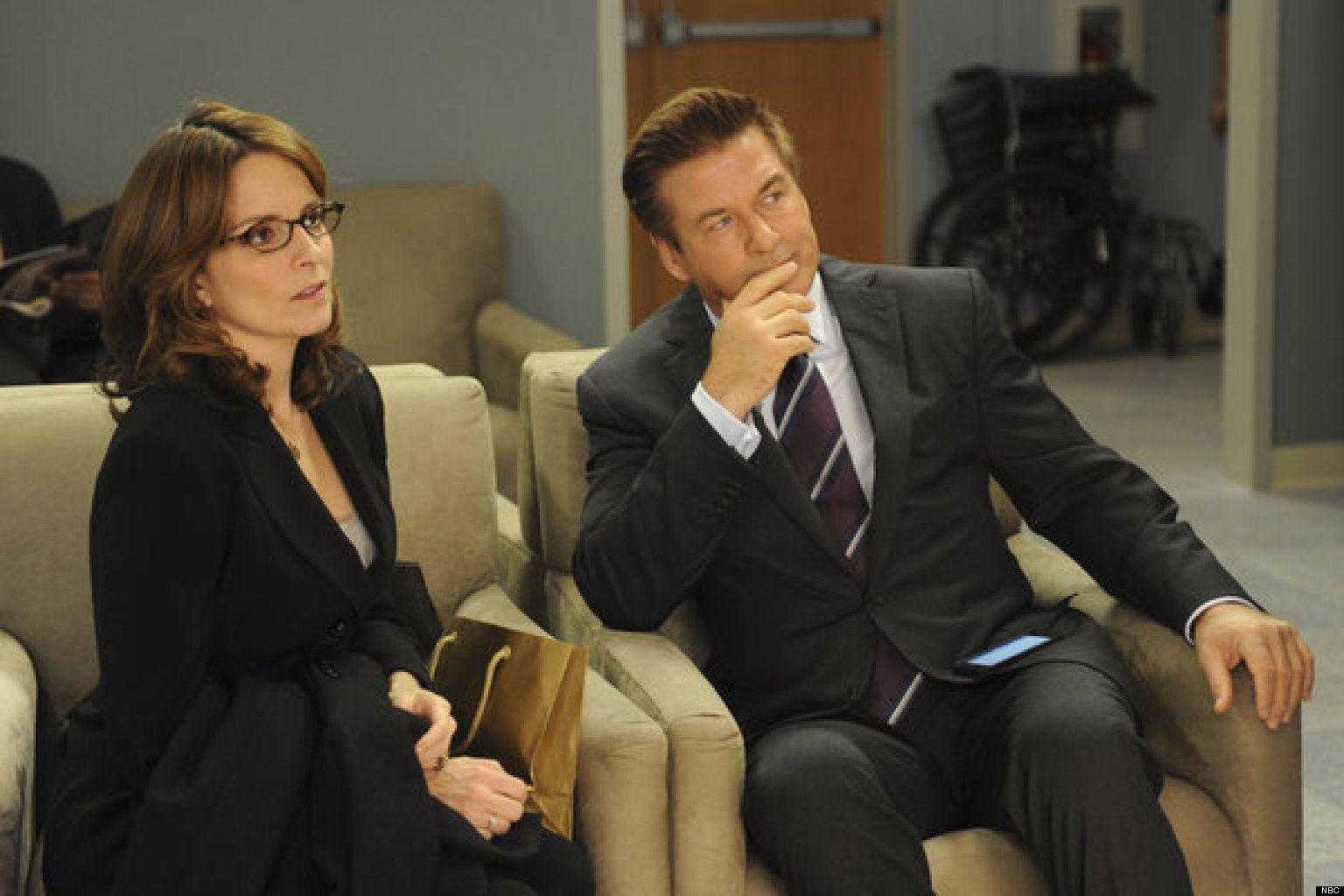 Alec Baldwin sits next to Tina Fey on 30 Rock