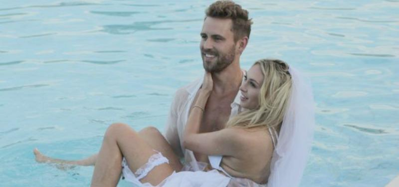 The Bachelor's Nick and Corinne in the water in wedding clothes