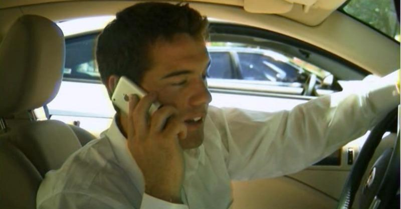 Alan Bagh is talking on the phone in a car.